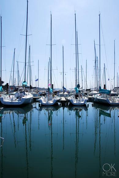 Travel photography destination France: Bretagne trinite sur mer marina port sailboats reflection morbihan