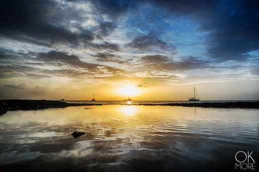 Landscape photography: sunset reflections and sailboats in the caribbean, Cozumel, Mexico