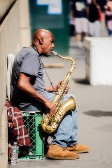 Travel photography destination New York: downtown street musician sax player manhattan