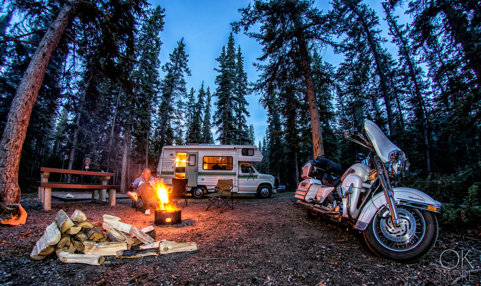 Travel photography, destination Canada Rockies campfire, lifestyle, campervan and harley motorcycle