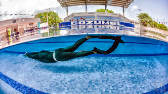 Commercial photography: freedive training, swimming pool, underwater split shot