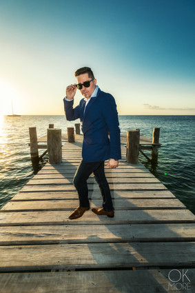 Musician photography. Portrait of Gio Ortega at a pier