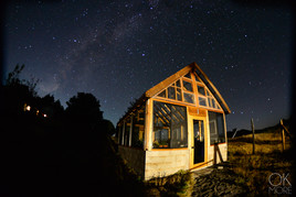 Travel photography destination California: humboldt night sky, milky way in the hills, greenhouse
