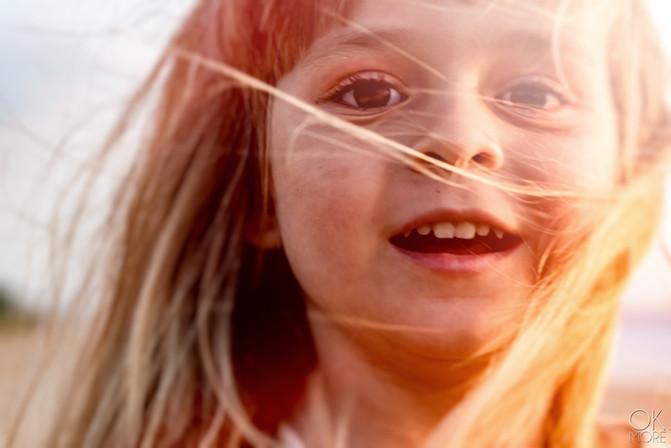 Child portrait at a windy sunset