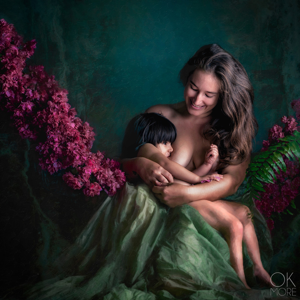 Motherhood, fine art portrait of mother breastfeeding her child