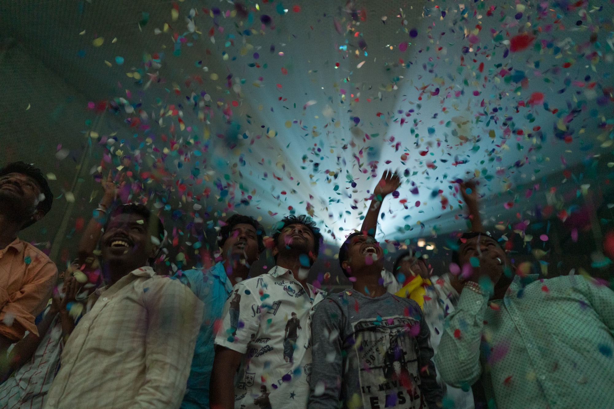 'Fans' seen awaiting the on-screen entry of 'Hat-trick hero' Shiva Rajkumar during the premiere of h