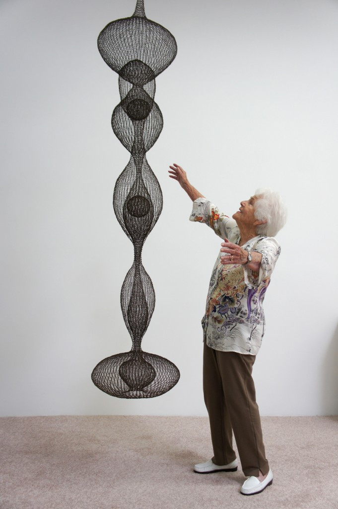 Ruth Asawa with one of her signature hanging sculpture
