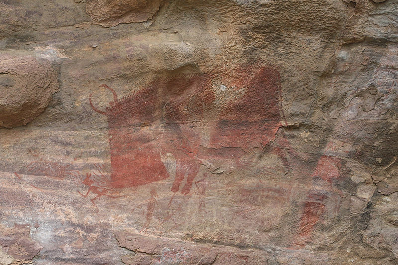 "The only painting in the caves showing, ""a man"" being hunted by a beast, a horned boar."