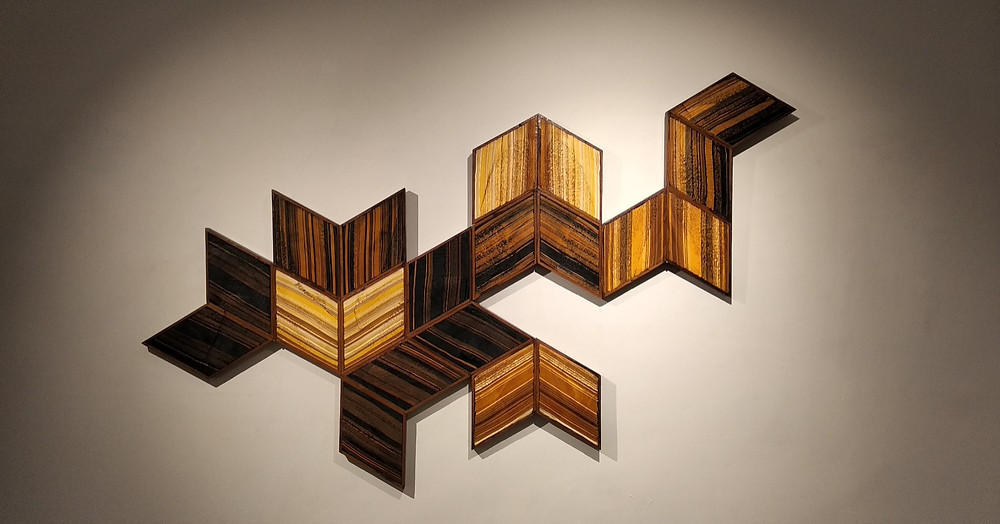 Artwork by Kumaresan Selvaraj. Dyed recycled paper and wood.