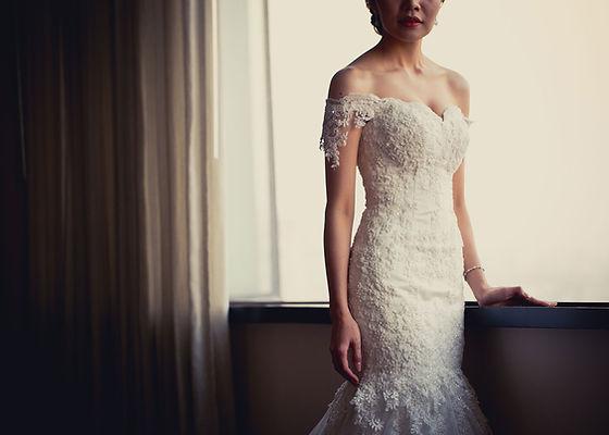Bride posing infront of window, elegant dress