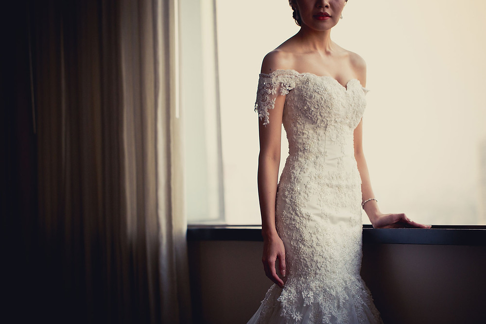 Couture wedding dress in beaded lace