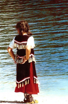 1st Nation Indians - Ontario, Canada 2000__Girl resting from dancing watching her friends take a swim.jpg