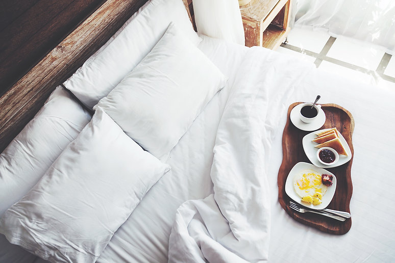 Breakfast on a tray in bed in hotel, whi