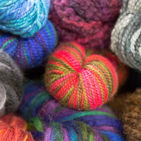 Pile of Hand-painted yarn skeins.