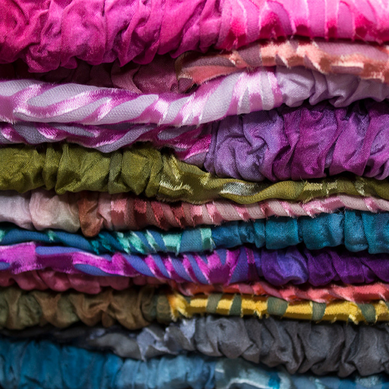A Pile of Dyed Silk Cowls