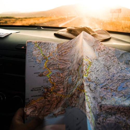 A road map on a car dashboard.