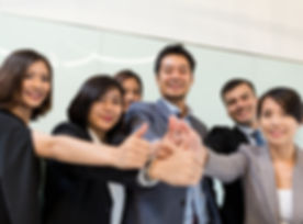 Business people showing thumb up.jpg