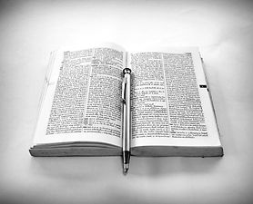 grayscale-photography-of-click-pen-on-to