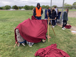 Shelter building in the rain!