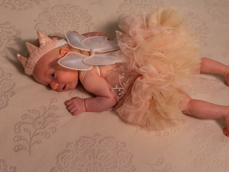 Newborn Photos: How To Take Beautiful Photos of Crying Babies
