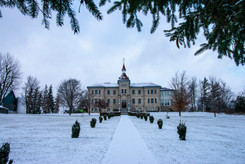 Long path leading to the Wellington County Museum and Archives on a lightly snow covered day