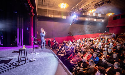 Fergus Grand Theatre stage with audience and performer