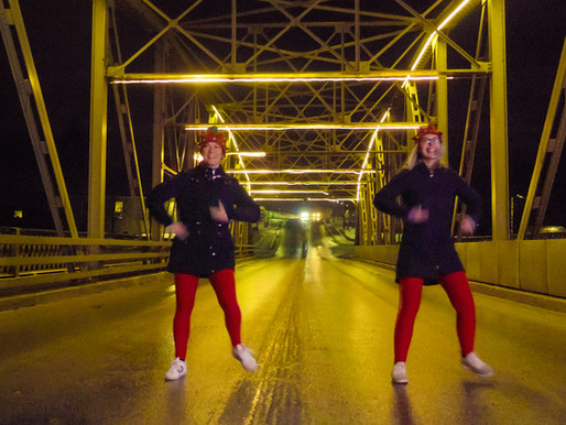 Elora & Fergus, did you see these two elves dancing the streets?