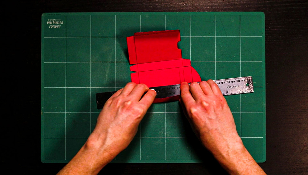 Fig 14. Use a ruler and fold card box edges and tabs
