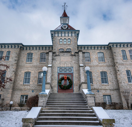 Standing at the steps of the Wellington County Museum and Archives on a winter day