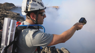 Frederick Schuett checks the temperature of the volcano in Ethopia