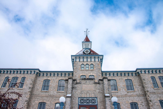 Looking up at the Wellington County Museum and Archives and blue sky