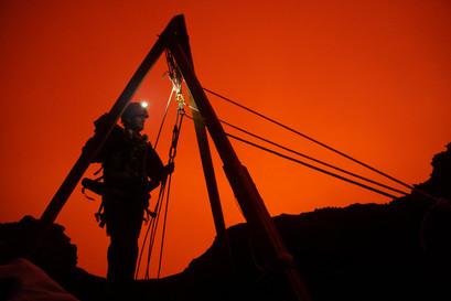 Silhoutte of rigging for zipline over volcano