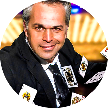 Magician Joe Holiday springing playing cards from his hands