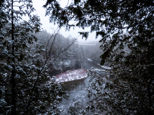 A snowy Elora Gorge framed by snow covered trees