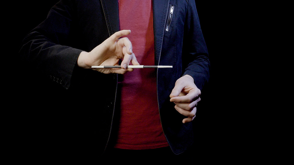 Magician reveals how the growing wand magic trick works