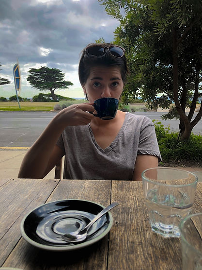 Applied Sociologist Stephanie Wilson Drinking Coffee along the Great Ocean Road