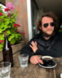 Applied Sociologist Luke Hanna Drinking Coffee in Australia
