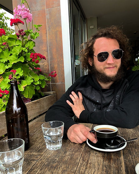 Applied Sociologist Luke Hanna Drinking Coffee in Australia