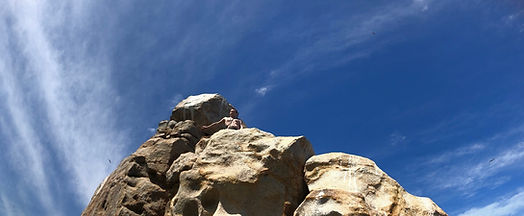 Applied Sociologist Lucas Hanna at the top of pelican rock in cabo san lucas mexico