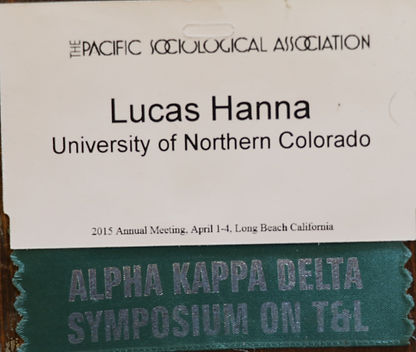 Lucas Hann Conference tag from the Pacific sociological association and Alpha Kappa Delta Symposium on teaching and learning