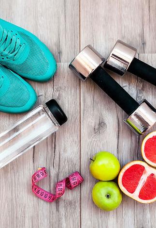 Fitness equipment. Healthy food. Sneaker
