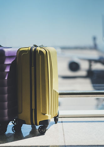 Suitcases in airport departure lounge, a