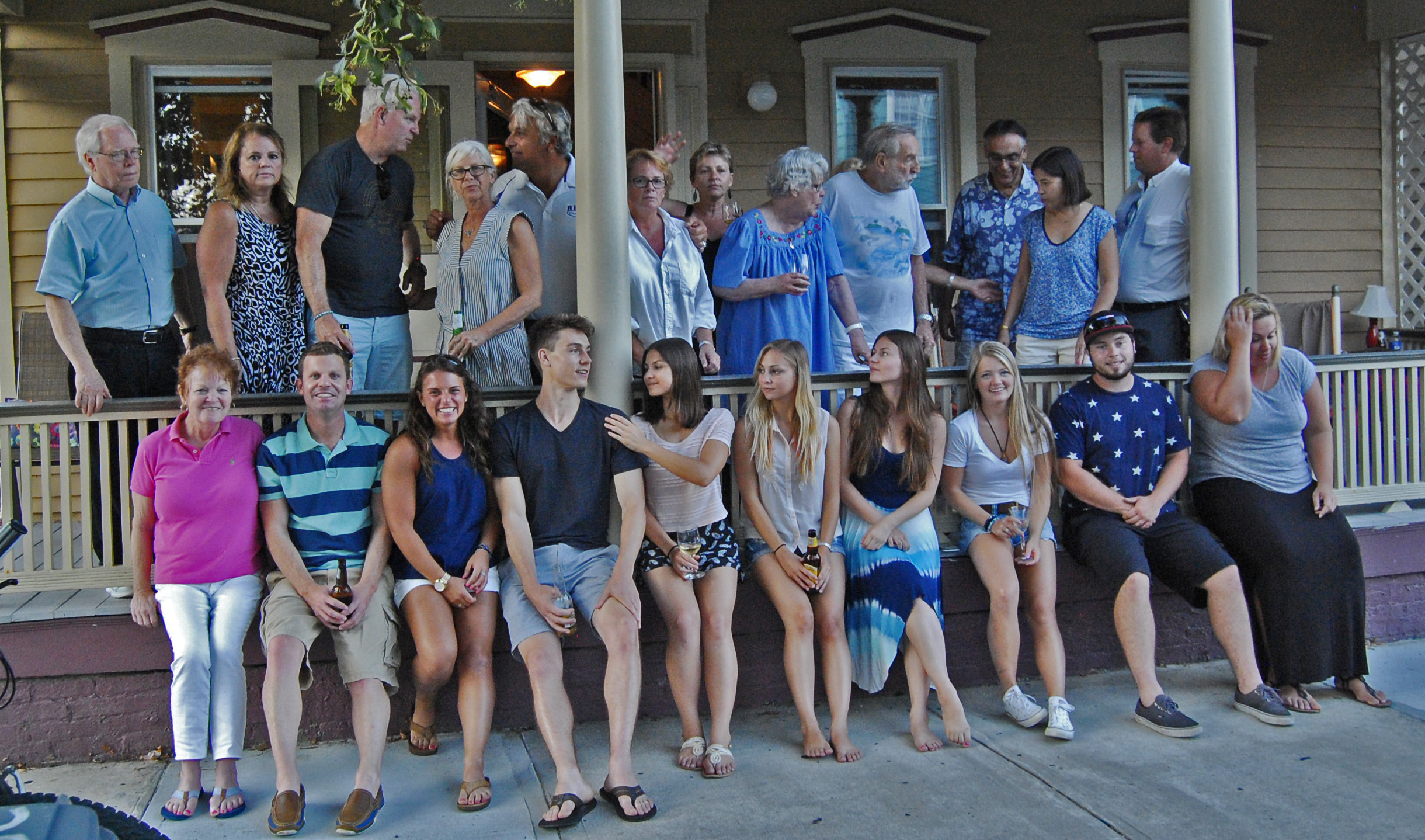 Casual group on Central ave. porch