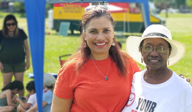 Councilwoman Kim Gray greets Bernice Tra