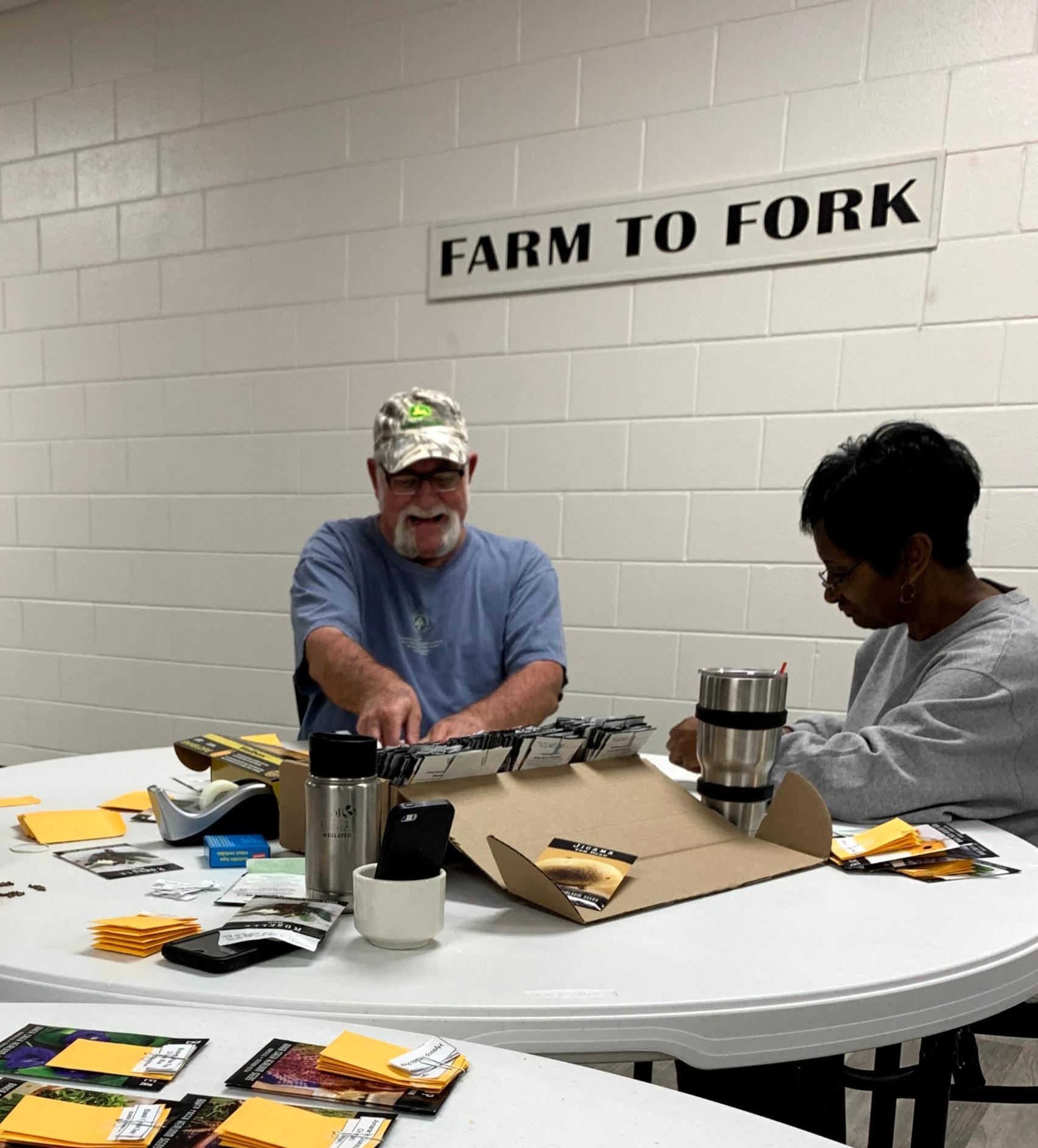 farm volunteers preparing for the seed s