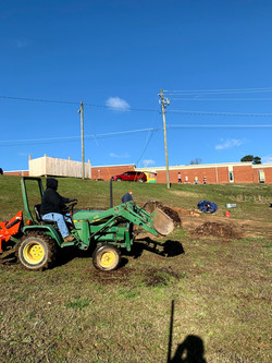 farm volunteers preparing compost