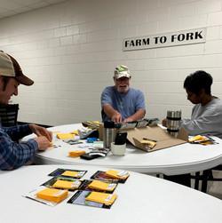 farm volunteers preparing for the seed swap