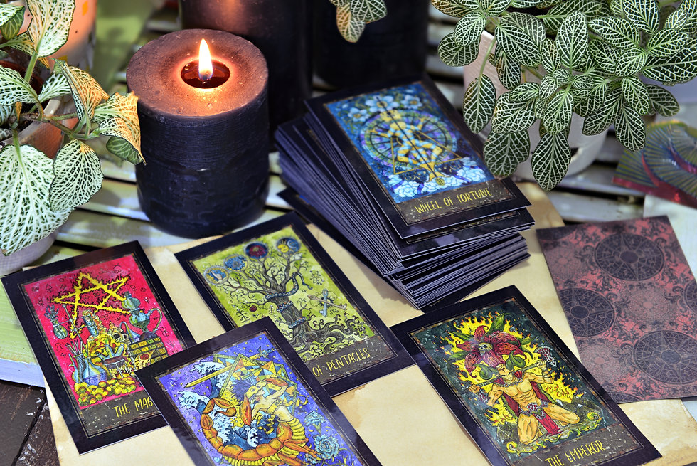 Still life with fantasy tarot cards and black candles.  Esoteric, wicca and occult background, fortu