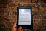person-holding-amazon-kindle-ebook-84473
