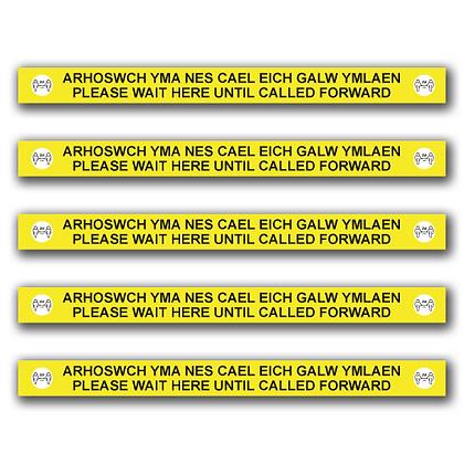 Bilingual 'PLEASE WAIT HERE' 600mm x 50mm Floor Stripe (Each)